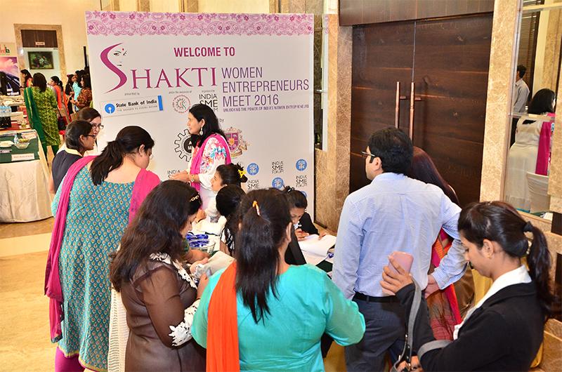 Women Entrepreneurs collecting their delegate cards & Kit from the Registration Desk