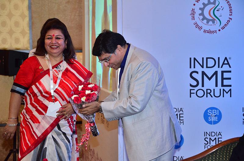 Felicitation of Mr. Vinod Kumar, President, India SME Forum by Ms.Ritu Grover