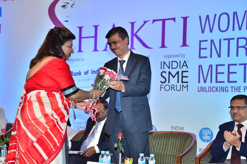 Felicitation of Ms. Ritu Grover, Director, Raman Foundation by Ms. Sushma Morthania