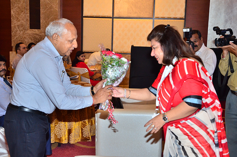 Felicitation of Mr. Om Dhoot, President ,AIMP by Ms.Ritu Grover
