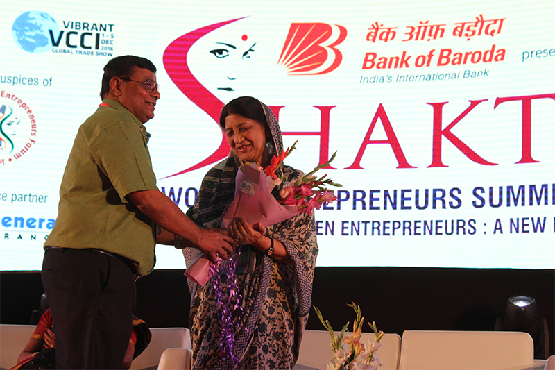 Rajmata Shubhangini Raje Gaekwad,Chancellor,The Maharaja Sayajirao University of Baroda being felicitated by Mr. Nilesh Shukla,President,VCCI