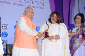 Smt Dipali Sikand, Founder Les Concierges  receiving her trophy from Shri Kalraj Mishra Union Minister for MSME