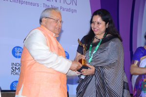 Smt Manjula Mishra, Director Holosafe  receiving her trophy from Shri Kalraj Mishra Union Minister for MSME