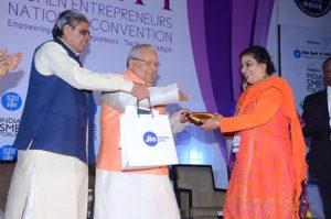 Smt Zaheda Kapade, Elite Pharma receiving her trophy from Shri Kalraj Mishra Union Minister for MSME & Shri Haribhai P. Chaudhary , MOS, MSME